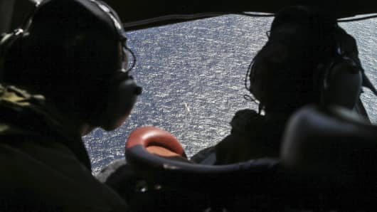 Commanders look out the cockpit windows during search operations for missing Malaysia Airlines Flight MH370 in Southern Indian Ocean, near Australia.